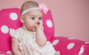 3 Month Old Baby Girl Sucking Her Thumb in Pink Polka Dot Chair