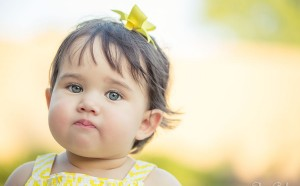 1 Year Old Baby Girl Outside With Yellow Dress and Bow