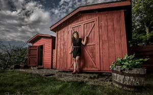 Senior Photography with Clouds and Red Barn