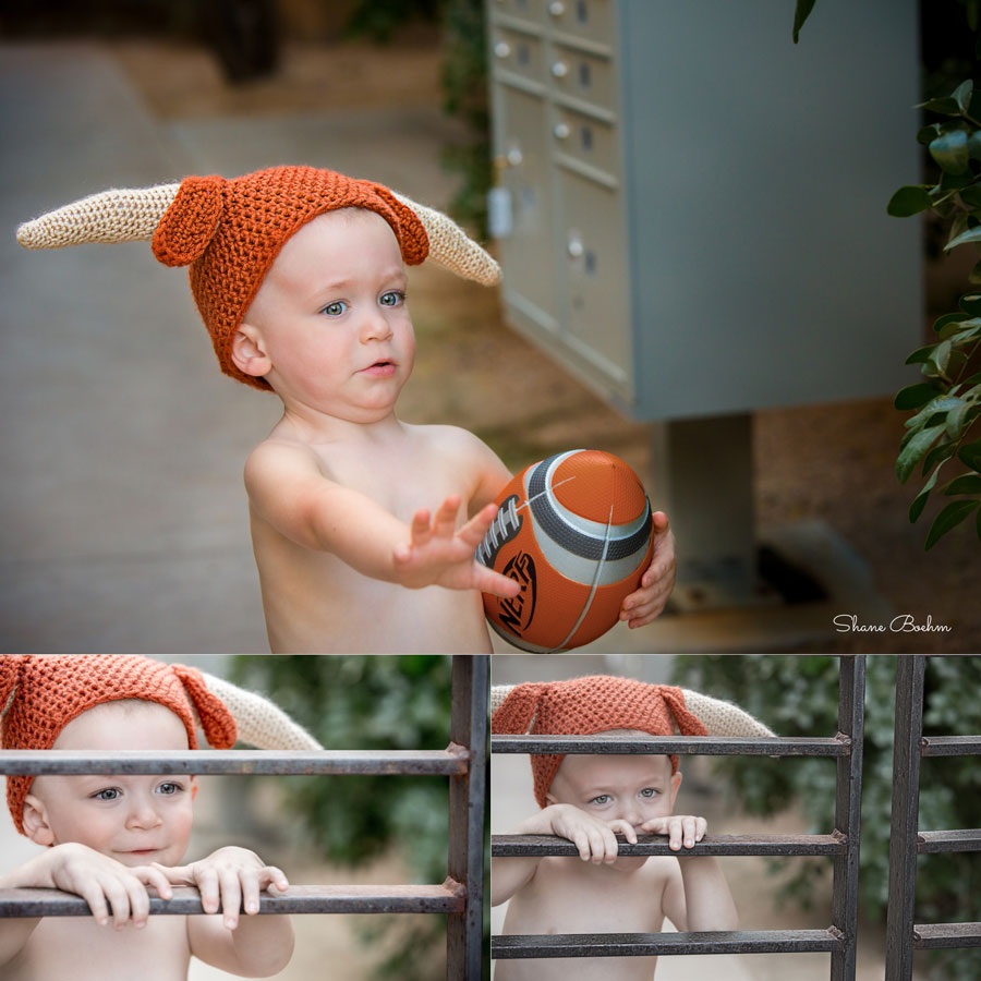 2 year old boy with football and longhorns knitted hat